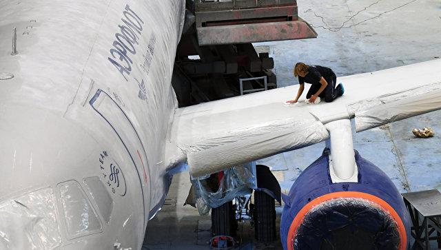 Покраска самолета Sukhoi Superjet 100 в ливрею авиакомпании Аэрофлот