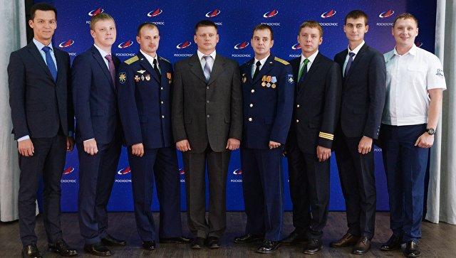 Космонавты, поступившие в отряд по итогам 1,5-летнего отбора, на церемонии представления в Москве. 10 августа 2018