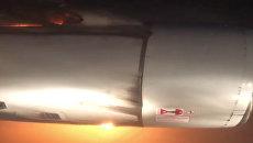 Горящий двигатель пассажирского Ту-204. Архивное фото