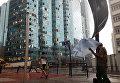 Разбитые окна в здании после тайфуна Мангхут в Гонконге, Китай. 16 сентября 2018 года