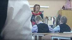 Стоп-кадр видеозаписи урока музыки в школе города Пушкин