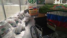Российские военные передали коляски и вещи инвалидам войны в сирийском госпитале