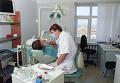 Прием больного в кабинете стоматологической поликлинике