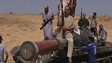 Переходный национальный совет Ливии предложил сторонникам Каддафи сложить оружие