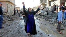 Женщин на месте взрыва в городе Киркук, Ирак