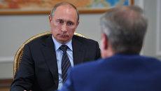 Президент России Владимир Путин (слева) и глава Сбербанка Герман Греф. Архивное фото