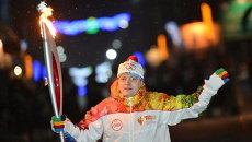 Факелоносец Максим Ведяшкин во время эстафеты Олимпийского огня в Томске