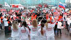 Эстафета в Новосибирске: чемпионы с Огнем и дети с плакатами