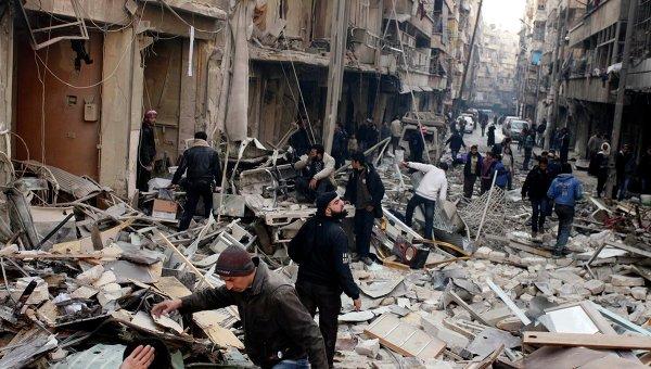 Последствия авиаударов в Алеппо, декабрь 2013. Архивное фото