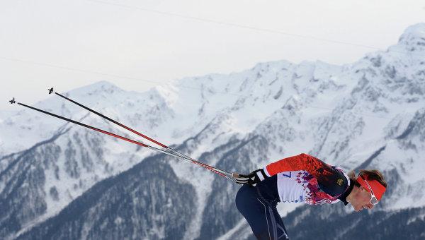 Максим Вылегжанин (Россия) на дистанции скиатлона в соревнованиях по лыжным гонкам среди мужчин на XXII зимних Олимпийских играх в Сочи