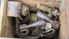 Коллекция вещей и оружия, сохранившаяся с времен ВОВ. Архивное фото