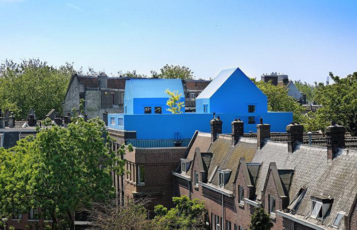 Деревушка семьи Дидден на крыше частного здания в Нидерландах